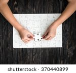 hands completing wthite puzzle... | Shutterstock . vector #370440899