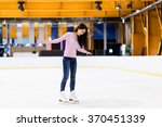 Woman On Skating Rink