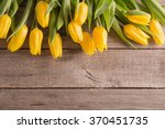 Yellow Tulips Over Wooden Tabl...