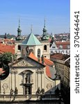Small photo of PRAGUE, CZECH REPUBLIC - CIRCA OCTOBER 2010: St Salvatore church façade and green dome and towers