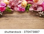 Stock photo floral arrangement with orchids roses and carnations on wooden background copy space 370473887