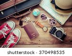 travel accessories on wooden... | Shutterstock . vector #370498535