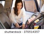 pretty brunette fastening the... | Shutterstock . vector #370514357