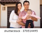 pretty young family with a baby ...   Shutterstock . vector #370514495