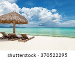 deck chairs on a beautiful... | Shutterstock . vector #370522295