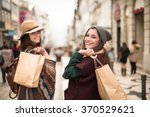 Young Trendy Women Shopping In...