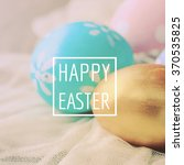 Stock photo pastel and colorful easter eggs with happy easter word 370535825