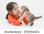 Stock photo little asian girl hugging lovely persian kitten on isolated 370556321