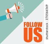 hand holding megaphone   follow ... | Shutterstock .eps vector #370566569