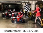 group of people is driving go... | Shutterstock . vector #370577201