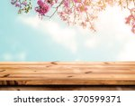 Stock photo top of wood table with pink cherry blossom flower on sky background empty ready for your product 370599371