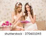 two beautiful happy girls... | Shutterstock . vector #370601045