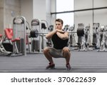 young man flexing muscles with... | Shutterstock . vector #370622639
