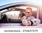 young man and woman smile at... | Shutterstock . vector #370657379