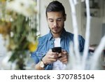 young handsome man using mobile ... | Shutterstock . vector #370785104
