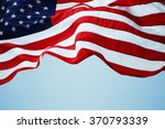 An American Flag Flowing In Th...