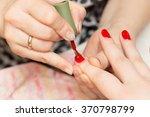 manicure in a beauty salon | Shutterstock . vector #370798799