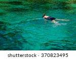 women diving with snorkel in... | Shutterstock . vector #370823495