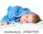 cute baby in a towel | Shutterstock . vector #370827935