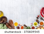herbs and spices over wood... | Shutterstock . vector #370839545