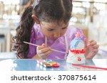 close up of  kid painting color ... | Shutterstock . vector #370875614