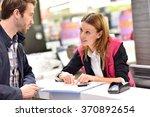car rental assistant giving... | Shutterstock . vector #370892654