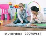 private teacher and small boy... | Shutterstock . vector #370909667