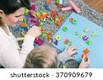 boy during session with speech... | Shutterstock . vector #370909679