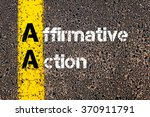 Small photo of Concept image of Business Acronym AA Affirmative Action written over road marking yellow paint line.