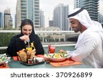 emirati arab couple dining in a ... | Shutterstock . vector #370926899