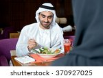 emirati arab couple dining in a ... | Shutterstock . vector #370927025