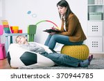 misbehaving boy lying on sack... | Shutterstock . vector #370944785
