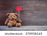 Teddy Bear With Heart Sitting...