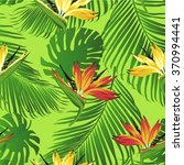 tropical flowers and leaves on... | Shutterstock .eps vector #370994441
