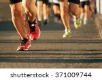 marathon running in the light... | Shutterstock . vector #371009744