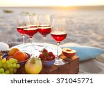 glasses of the red wine on the... | Shutterstock . vector #371045771
