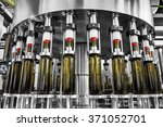 bottle filling wine bottles... | Shutterstock . vector #371052701
