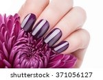 beautiful red nails and flower... | Shutterstock . vector #371056127