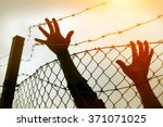 refugee men and fence. refugee... | Shutterstock . vector #371071025