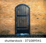 Old Wood Door On Red Brick Wal...