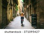Woman Riding Bicycle Through...