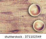 Two Coffees On A Rustic Wood...