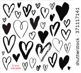 real ink hand drawn hearts.... | Shutterstock .eps vector #371117141