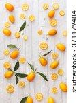 fresh organic kumquats.... | Shutterstock . vector #371179484