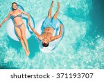 happy couple on lilos in the... | Shutterstock . vector #371193707