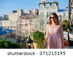 beautiful woman in glasses on a ... | Shutterstock . vector #371215195