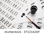 learning calligraphy   paper... | Shutterstock . vector #371216269