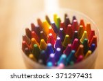 crayons shot from above with... | Shutterstock . vector #371297431