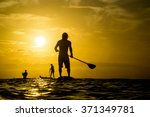 a company of young surfers... | Shutterstock . vector #371349781