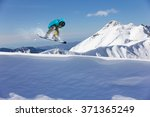 flying snowboarder on mountains.... | Shutterstock . vector #371365249